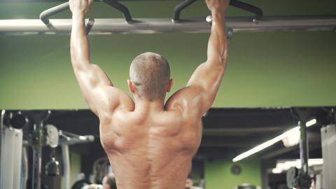 Bodybuilder do horizontal bar workout Footage