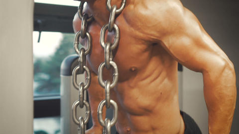 Bodybuilder do timbers workout with chain Footage
