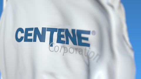Flying flag with Centene Corporation logo, close-up. Editorial loopable 3D Live Action