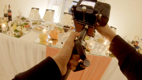 videographer filming a wedding table in a restaurant Live Action