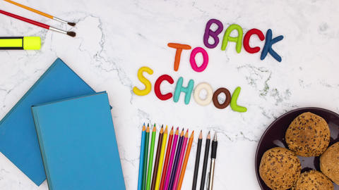 Back to school - Stop motion animation of school supplies appear and disappear from the table and Animation