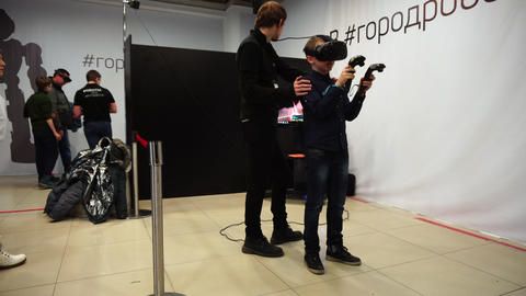 Lipetsk, Russian Federation - January 25, 2018: Exhibition of robots. A child Live Action