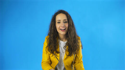 A woman feels pleasure close her eyes in Studio with blue Background Footage