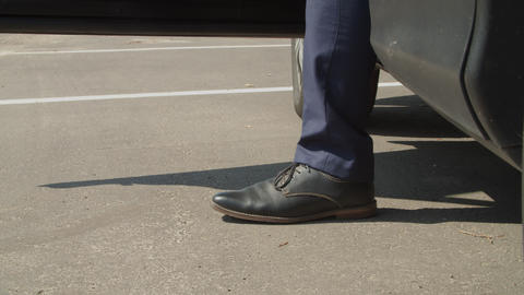 Businessman in elegant shoes exiting parked car Footage