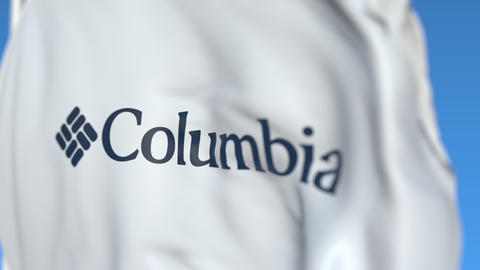 Waving flag with Columbia Sportswear logo, close-up. Editorial loopable 3D Live Action