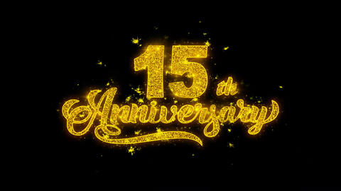 15th Happy Anniversary Typography Written with Golden Particles Sparks Fireworks Footage