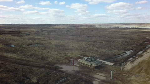 A tank shoots at a shooting range Live Action