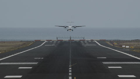 An airport runway with a landing plane Footage