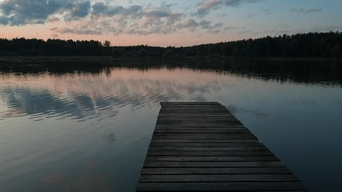 A narrow wooden pier over a lake Footage