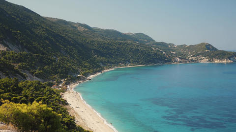 Very beautiful beach with blue water near mountains in greece. Perfect shot for tourism advertising Live Action
