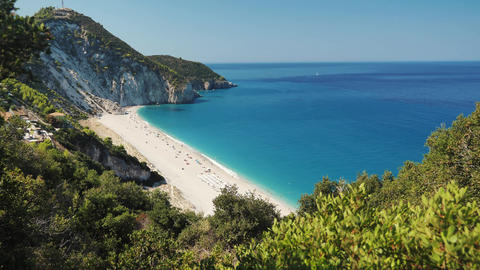 Beautiful beach with blue sea water in greece. Milos beach in Lefkada Island above view with a nice Live Action