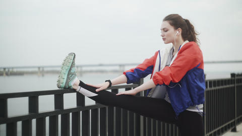 Sport woman Stretching Legs before running outdoor Live Action