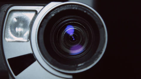 Camera zoom. Taking a close-up video cameras, increasing or decreasing scale Live Action