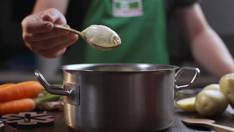 Chef adds cream cheese to the meal while cooking, the cook puts some ricotta to Live Action