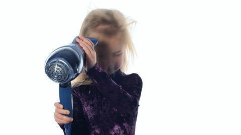 Little girl dries hair Footage