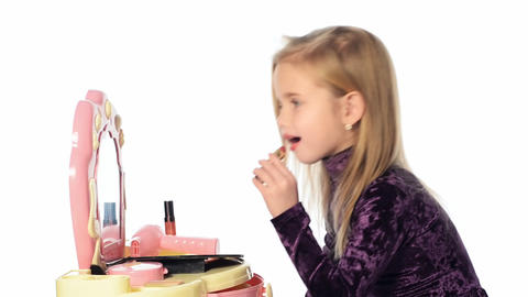 closeup portrait of the little girl with lipstick Stock Video Footage