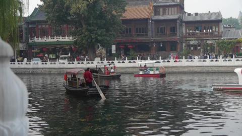 Beijing ferry boat traveling on HouHai lake Stock Video Footage