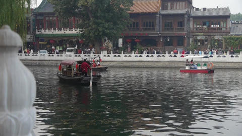 Beijing ferry boat traveling on HouHai lake Stock Video Footage