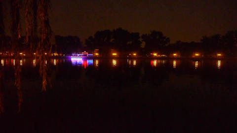 reflection on lake with splendid China ancient architectural lighting & will Footage
