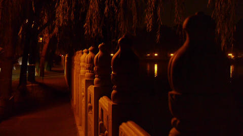 shore of stone railings.reflection on lake with splendid... Stock Video Footage