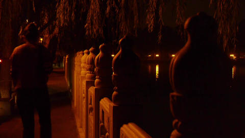 shore of stone railings.reflection on lake with splendid China ancient architect Footage