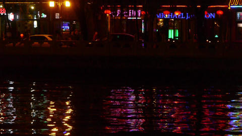 reflection on lake with splendid China ancient architectural lighting.pedestrian Footage