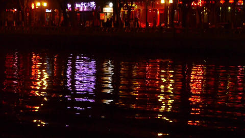reflection on lake with splendid China ancient architectural lighting at night.p Footage