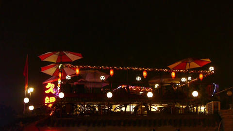Beijing Hutong roof Neon bar,decorative umbrella lighting in night Footage