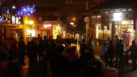 Crowd pedestrian people Walk on China Beijing night market.Neon shop at HouHai Footage