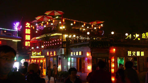 Crowd pedestrian people Walk on China Beijing bar market.Neon shop Timelapse Footage