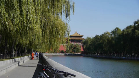 Chinese ancient buildings tower & willow relying on river in Beijing Forbidd Footage