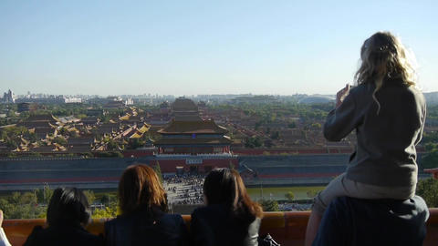 Father carrying daughter to see the Beijing Forbidden... Stock Video Footage