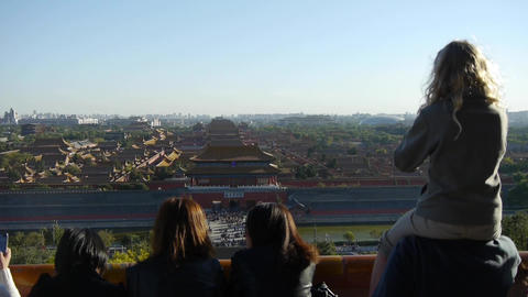 Father carrying daughter to see the Beijing Forbidden City.Many tourists people  Footage