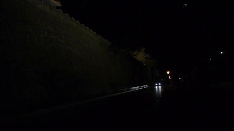 Car driving under the Great Wall battlements.Panoramic of... Stock Video Footage