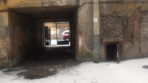 A passage under the arch of the building Stock Video Footage