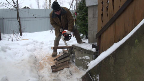 A man with a chainsaw Stock Video Footage