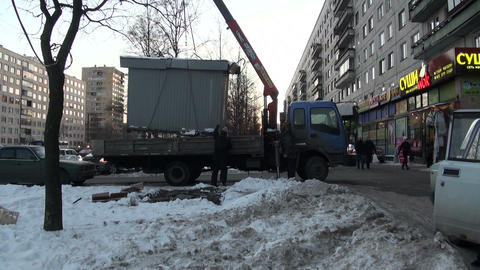 Crane lifts stall Stock Video Footage