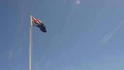Australian Flag Flying Against Blue Sky Footage