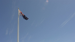 Australian Flag Flying Against Blue Sky Stock Video Footage