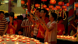Thai Family Praying by Candlelight at a Temple During... Stock Video Footage