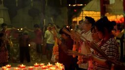 Thai People Praying by Candlelight at a Temple During... Stock Video Footage