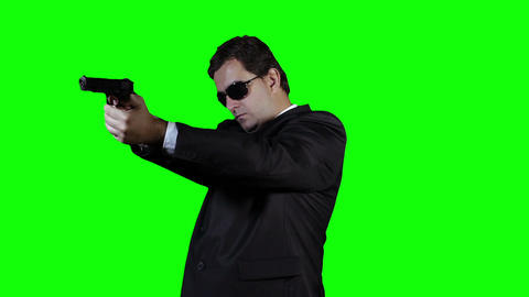Bodyguard with Pistol Gun Watching Action Greenscreen 35 Stock Video Footage