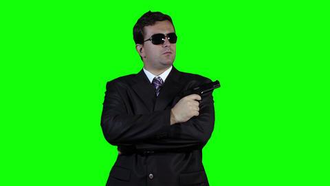 Bodyguard with Pistol Gun Watching Greenscreen 32 Stock Video Footage