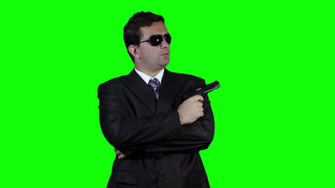 Bodyguard with Pistol Gun Watching Greenscreen 32 Footage