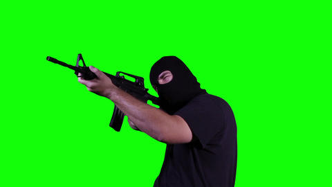 Man in Mask with Gun Action Greenscreen 20 Stock Video Footage