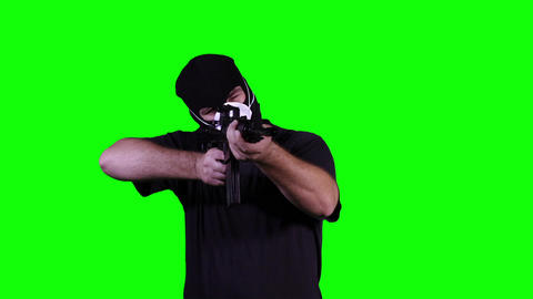 Man in Mask with Gun in Action Greenscreen 10 Stock Video Footage