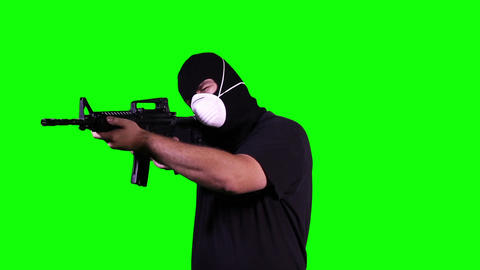 Man in Mask with Gun in Action Stop Go Greenscreen 9 Stock Video Footage
