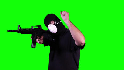 Man in Mask with Gun in Action Stop Go Greenscreen 9 Footage