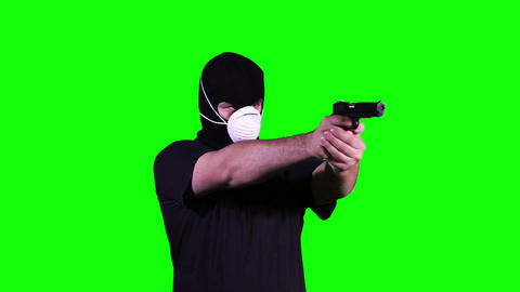 Man in Mask with Gun Pistol in Action Greenscreen 16 Stock Video Footage