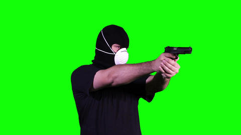 Man in Mask with Gun Pistol in Action Greenscreen 16 Footage